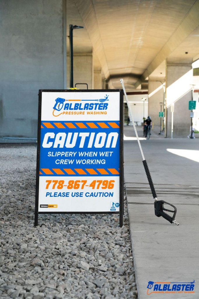 Alblaster pressure washing sign is placed on the sidewalk