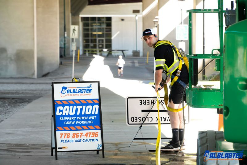 Pressure washing on Cambie Bridge in Vancouver. A contractor is doing site preparation