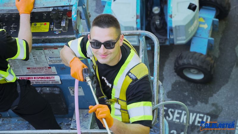 Pressure washing contractor smiling